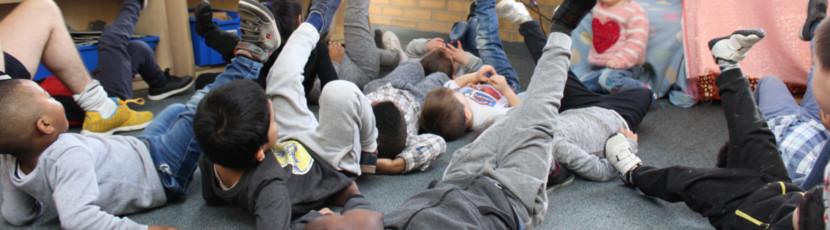 Children practising yoga